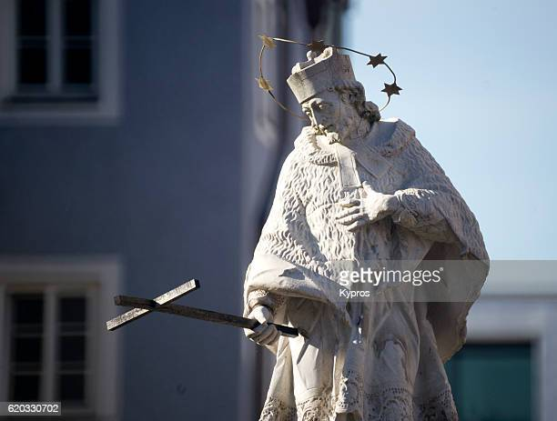 Europe, Germany, Bavaria, View Of Nepomuk Fountain Stature Of Man Holding Cross (Or Der Nepomuk-Brunnen)
