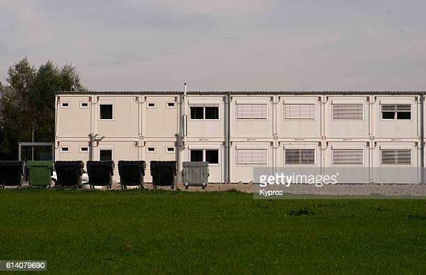 Europe, Germany, Bavaria, View Of Refugee Camp Made From Steel Cargo Shipping Containers In An Area With Million Euro Homes
