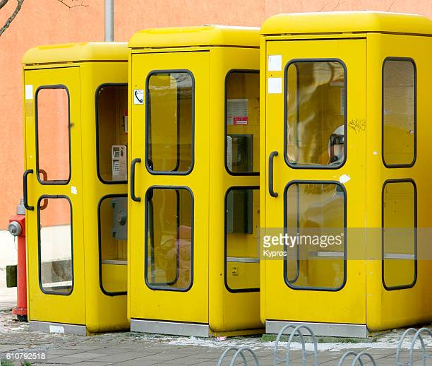 Europe, Germany, Bavaria, View Of Row Of Yellow Telephone Booths