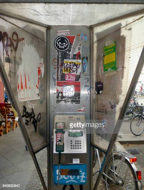 Europe, Germany, Berlin, View Of Graffiti Covered Payphone Telephone Booth