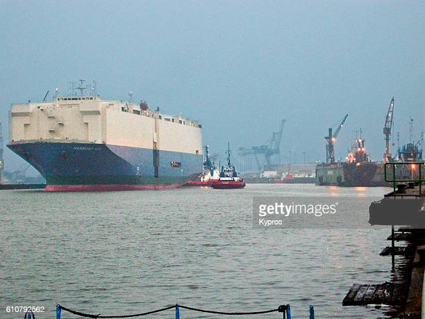 Europe, Germany, Bremerhaven, View Of Port With Huge Cargo Ship