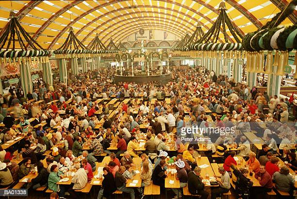 europe, germany, munich, crowd at beer festival, elevated view - オクトーバーフェスト ストックフォトと画像