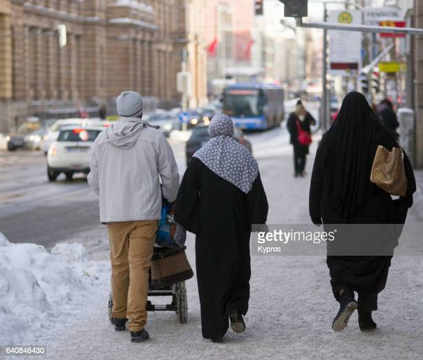 Europe, Germany, Munich, View Of Street Scene With Muslim People Walking, Pushing Pram