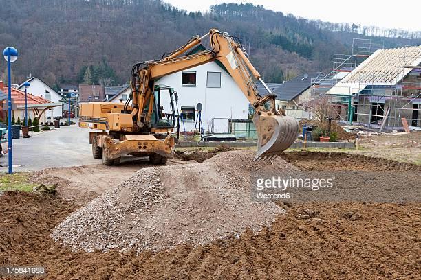 Europe, Germany, Rhineland Palatinate, Preparing ground for house foundation