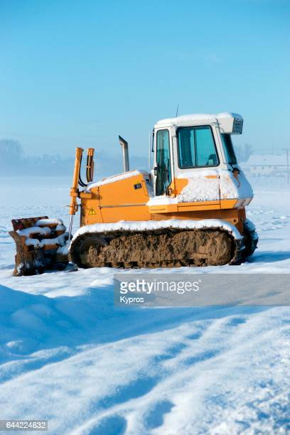 Europe, Germany, Winter View Of Snow Covered Bulldozer