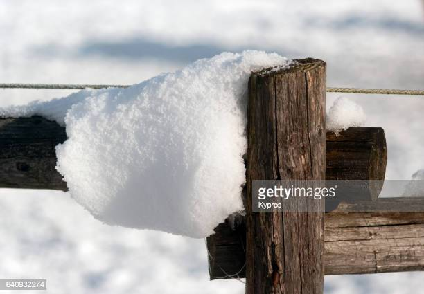 Europe, Germany, Winter View Of Snow Covered Wooden Fence Post