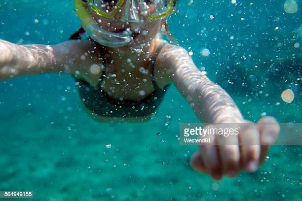 Europe, Girl snorkeling in sea