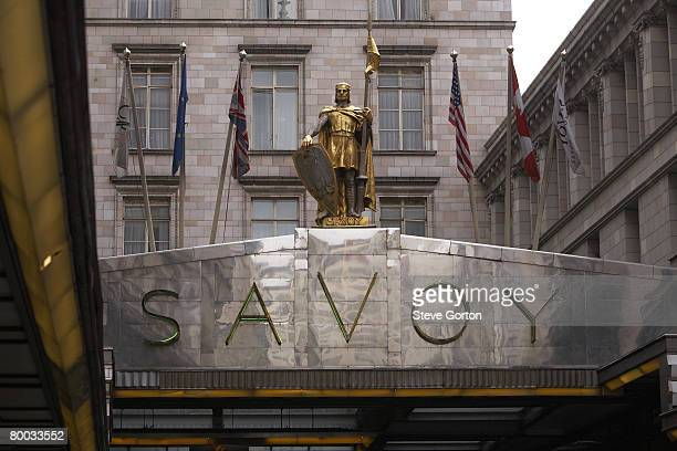 europe, great britain, england, london, the strand, entrance to savoy hotel with gilt statue of a knight and flags - the strand london stock pictures, royalty-free photos & images