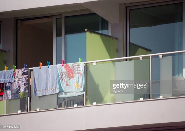 europe, greece, 2018: view of beach towels drying on balcony of tourist hotel - drying stock pictures, royalty-free photos & images