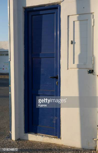 Europe, Greece, 2018: View Of Blue Door On Tiny Utility Building