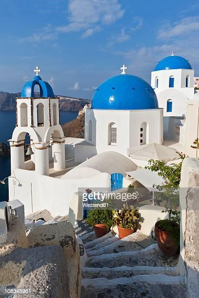 Europe, Greece, Aegean Sea, Cyclades, Thira, Santorini, Oia, View of blue dome and church