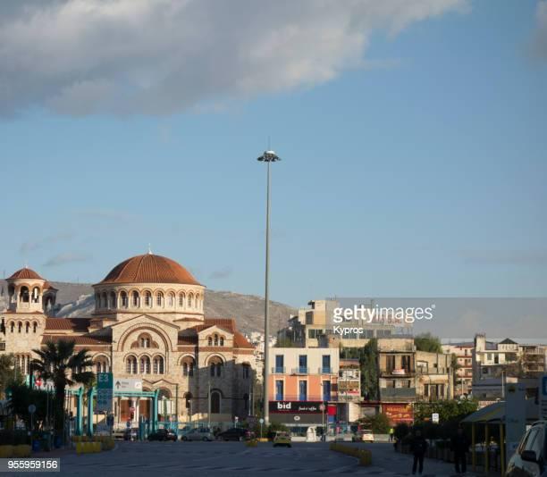 europe, greece, athens area, piraeus port, 2017: view of church - piraeus stock photos and pictures