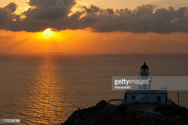 Europe, Greece, Cyclades, Thira, Santorini, Cliffs and lighthouse in Akrotiri at sunset
