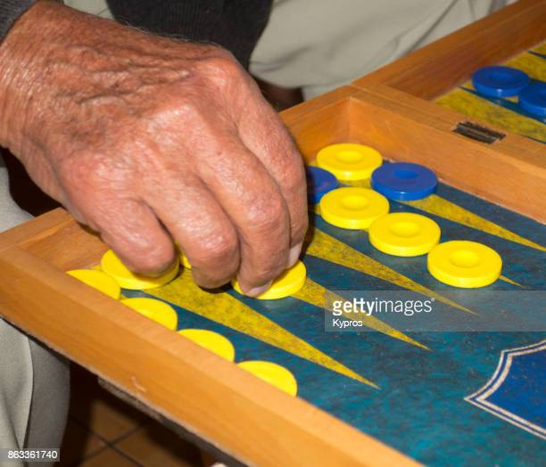 2017 - Europe, Greece, Cyprus, Troodos, Gerakies Village, View Of Greek Men Gambling. (Villagers Became Expert Card Players Due To Lack Of Electricity, TV Or Other Entertainment). Backgammon Players In The Cafe