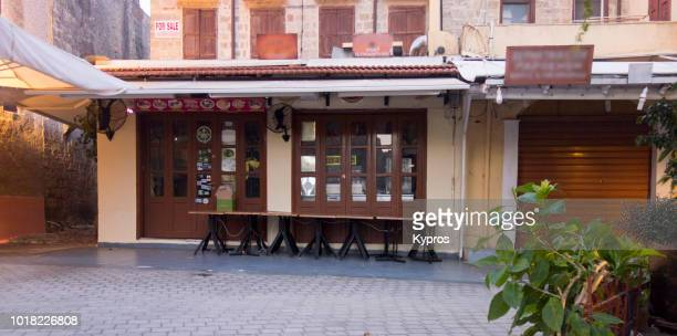 europe, greece, rhodes, 2018: view of cafe or restaurant in old town at night - {{asset.href}} stock pictures, royalty-free photos & images