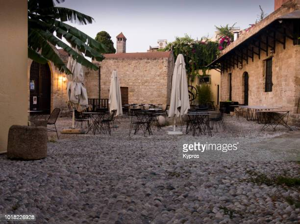 europe, greece, rhodes island, 2018: view of cafe or restaurant - {{asset.href}} stock pictures, royalty-free photos & images