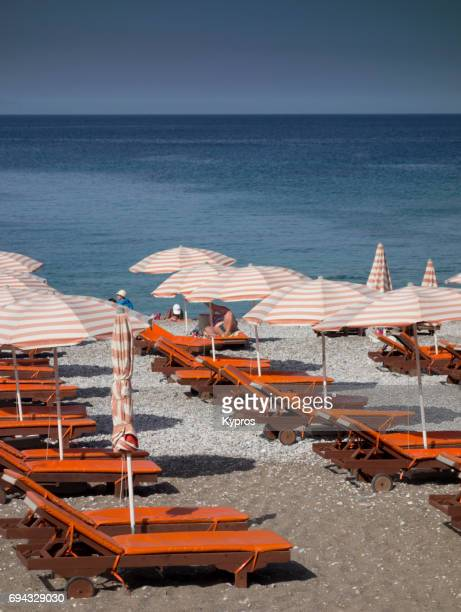 Europe, Greece, Rhodes Island, View Of Beach Chairs And Umbrellas