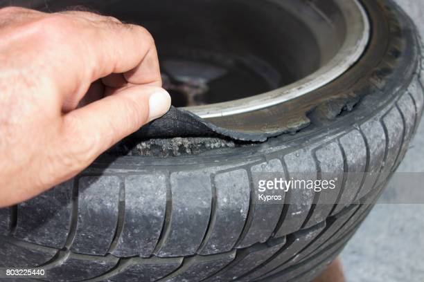 europe, greece, rhodes island, view of new sports car tire separating at side (sidewall damage) (replacement of this size not available) - puncturing stock pictures, royalty-free photos & images