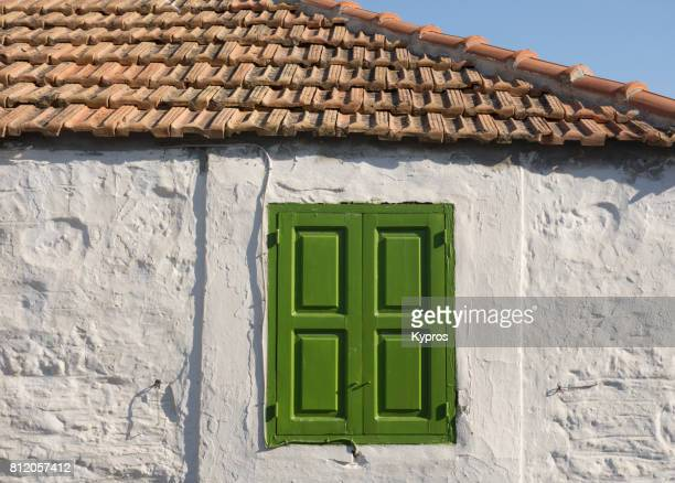 Europe, Greece, Rhodes Island, View Of  Shuttered Window On Traditional Greek Village House