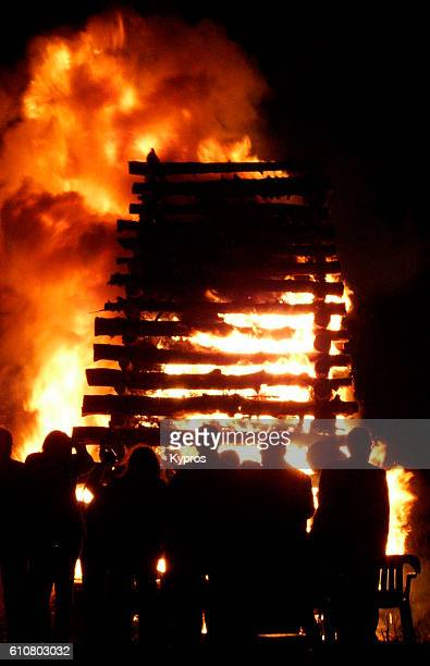 europe, greece, view of easter burning festival. it's illegal to destroy or cut tree's in greece, but if a priest (is bribed) says it's ok .... then fifty can be burned for fun in a single village at easter. - greek easter stock pictures, royalty-free photos & images