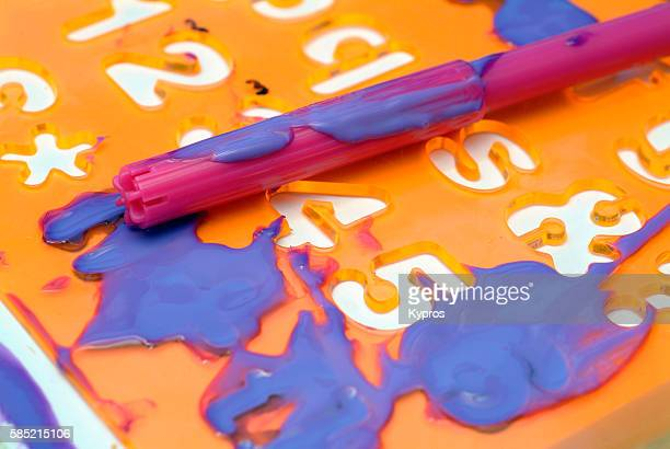 Europe, Greece, View Of Heating Pipes And Controls In Cellar Of Private Home Child's Toys Felt-Tipped Pens With Stencil And Messy Paint