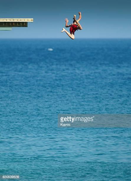 Europe, Greece, View Of Man Jumping Into Mediterranean Sea