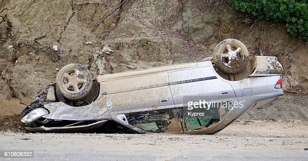 europe, greece, view of overturned car upside down - crash photos stock-fotos und bilder