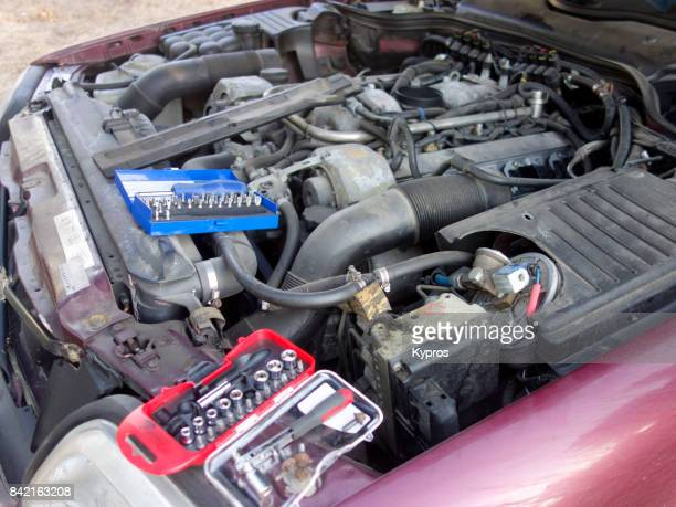 Europe, Greece, View Of Sports Car (6 Litre) V8 Engine Roadside Repair With Tools