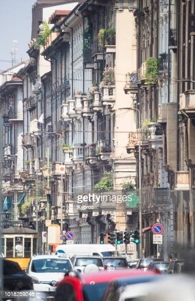 europe, italy, lombardy, milan, 2018: view of street scene with apartment building or block of flats - {{asset.href}} stock-fotos und bilder