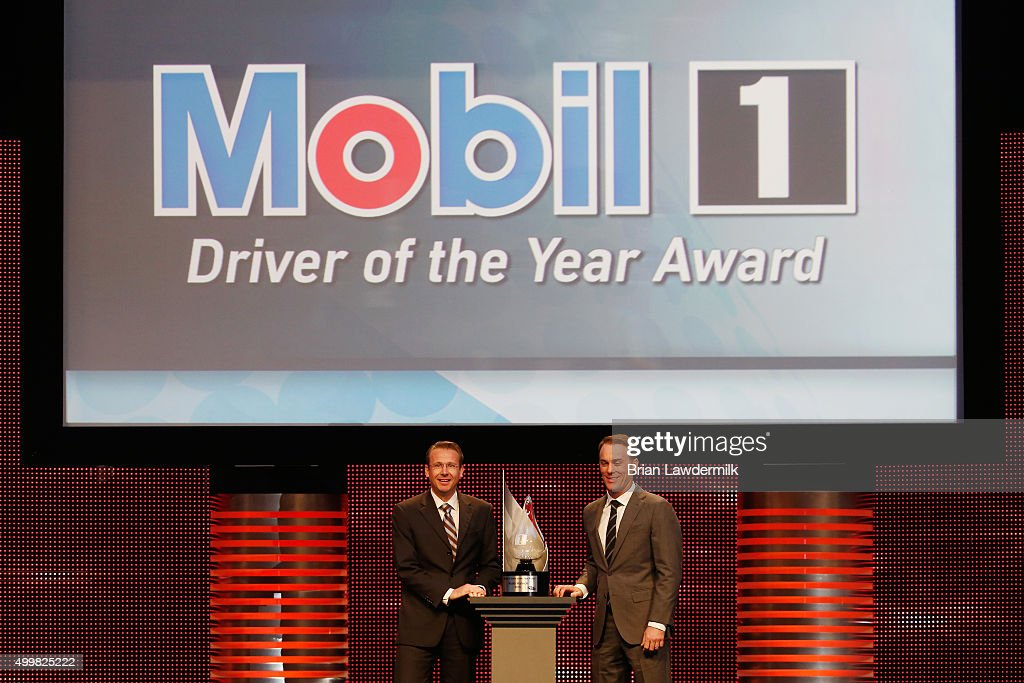 Europe Lubes Sales Manager Automotive for Mobil 1 Kai Decker presents NASCAR Sprint Cup Series driver Kevin Harvick with the Mobil 1 Driver of the Year Award during the 2015 NASCAR NMPA Myers Brothers Awards Luncheon at Encore Las Vegas on December 3, 2015 in Las Vegas, Nevada.