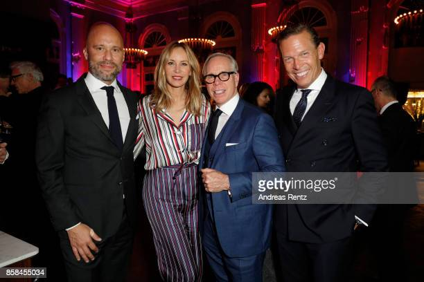 Europe Oliver Timm Dee Hilfiger Tommy Hilfiger and CEO Tommy Hilfiger and PVH Europe Daniel Grieder attend the Tommy Hilfiger VIP Dinner in...