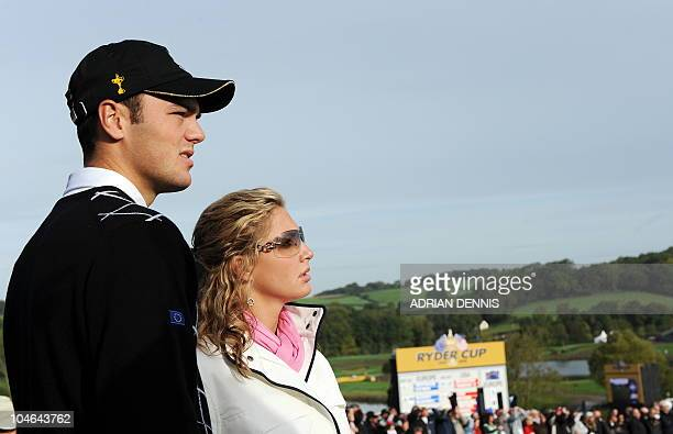 Europe Ryder Cup team player Martin Kaymer stands with his partner Allison Micheletti during the opening fourball round on the second day of the 2010...