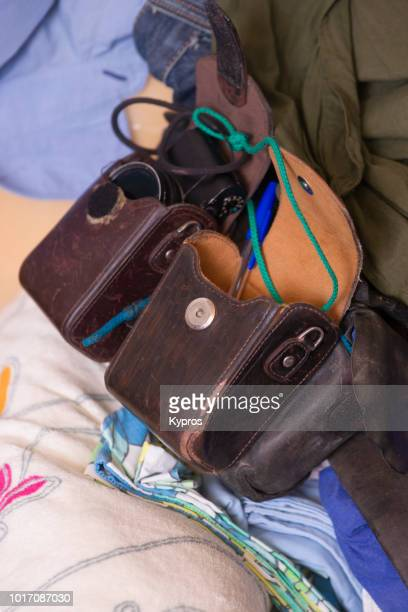 Europe, Spain, Balearic Isles, Ibiza, 2018: View Of Male Leather Purse (Or Gadget Bag) With Camera Case