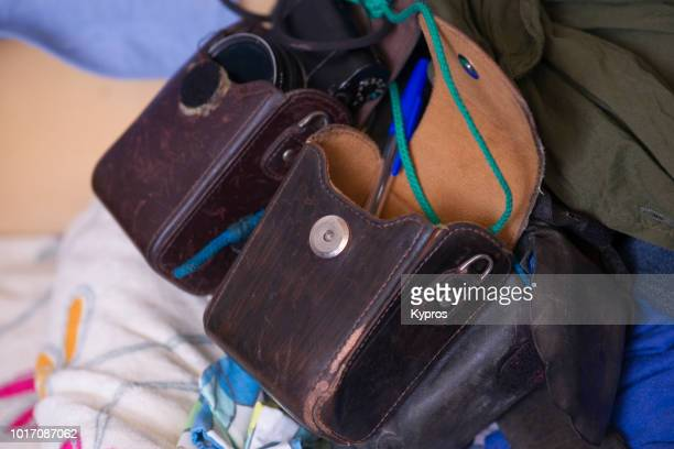 europe, spain, balearic isles, ibiza, 2018: view of male leather purse (or gadget bag) with camera case - ウエストポーチ ストックフォトと画像
