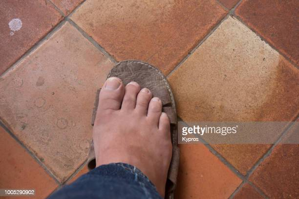 Europe, Spain, Balearic Isles, Ibiza, 2018: View Of Man Wearing Leather Sandals (Camel Skin, North African)
