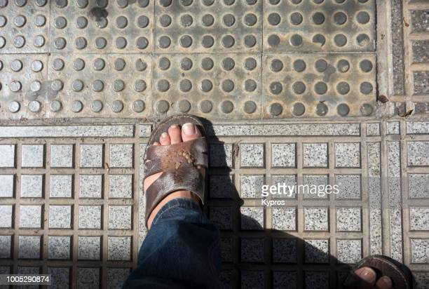 Europe, Spain, Balearic Isles, Ibiza Island, 2018: View Of Man Wearing Leather Sandals (Camel Skin, North African)