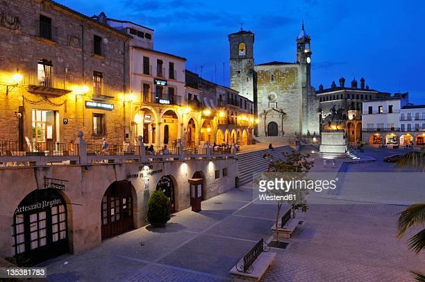 Europe, Spain, Extremadura, Trujillo, View of Plaza Mayor city square and San Martin church at dusk