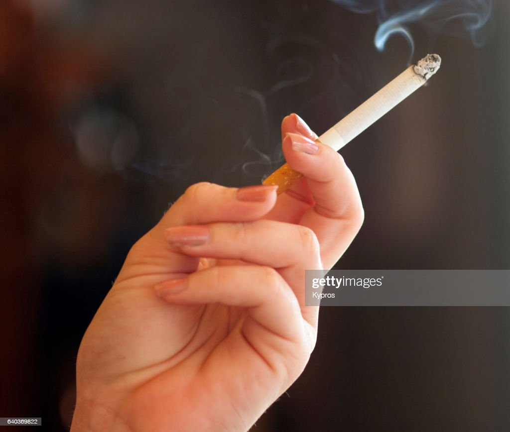 https://media.gettyimages.com/photos/europe-spain-malaga-view-of-woman-smoking-cigarette-close-up-of-hand-picture-id640369822