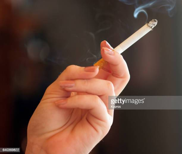 Europe, Spain, Malaga, View Of Woman Smoking Cigarette, Close Up Of Hand