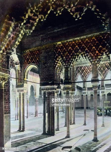 Europe Spain travel Andalusia Granada Alhambra arcaded sidewalk Moorish palace architecture 10th century image date 1910s 1920s Carl Simon Archive...