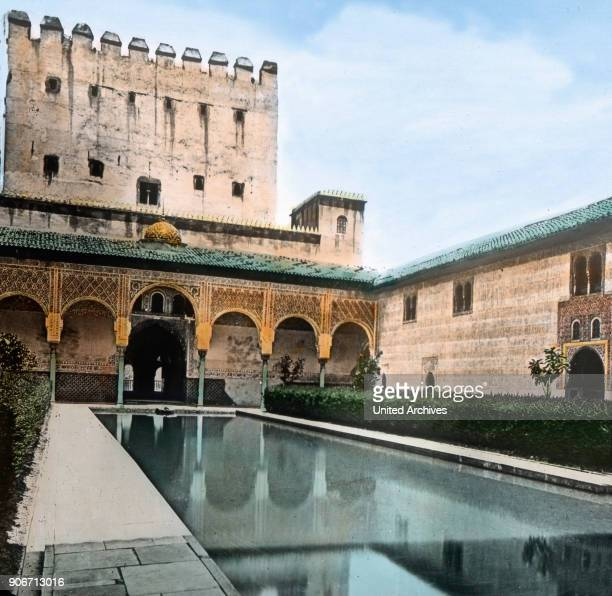 Europe Spain travel Andalusia Granada Alhambra Moorish Palace Court of the Myrtles Patio de los Arrayanes architecture 10th century image date 1910s...