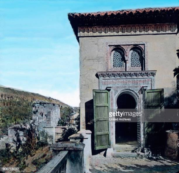 Europe Spain travel Andalusia Granada Alhambra view to a gate Moorish architecture 10th century image date 1910s 1920s history historical Carl Simon...