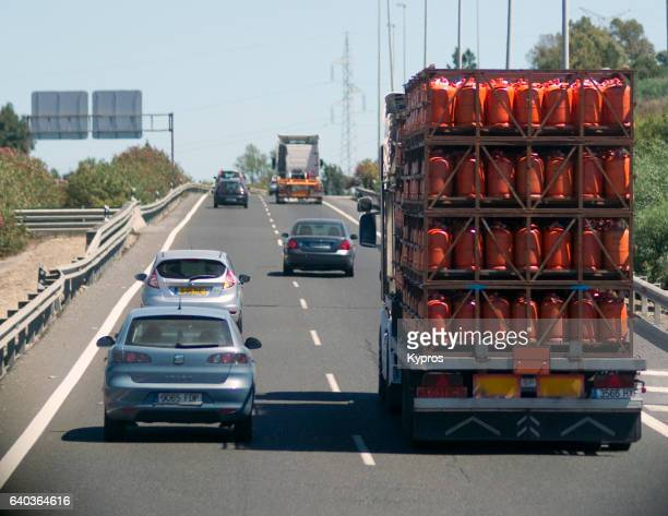 Europe, Spain, View Of Lorry Carrying LPG Gas Cylinders Driving On Highway
