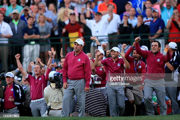 Europe team captain Jose Maria Olazabal and his team celebrate on the 18th green during day two of the Afternoon Four-Ball Matches for The 39th Ryder...