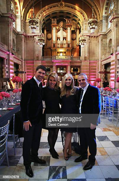 Europe team captain Paul McGinley and wife Allison pose with Europe team vice captain Padraig Harrington and wife Caroline Harrington during the 2014...