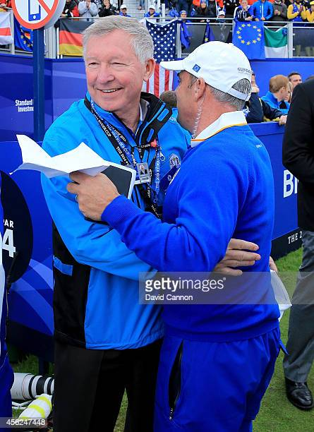 Europe team captain Paul McGinley embraces Sir Alex Ferguson on the 1st tee during the Singles Matches of the 2014 Ryder Cup on the PGA Centenary...