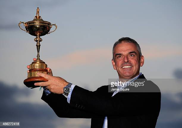 Europe team captain Paul McGinley lifts the Ryder Cup trophy after the Singles Matches of the 2014 Ryder Cup on the PGA Centenary course at the...
