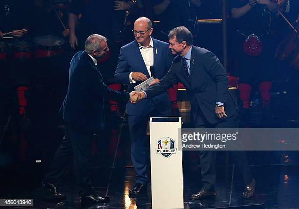 Europe team captain Paul McGinley shakes hands with United States team captain Tom Watson with Fred MacAulay during the 2014 Ryder Cup Gala Concert...
