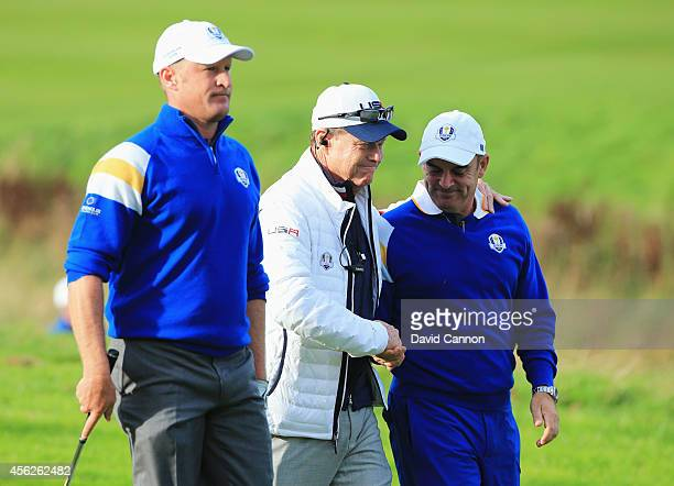 Europe team captain Paul McGinley shakes hands with United States team captain Tom Watson with Jamie Donaldson of Europe looking on shortly before...