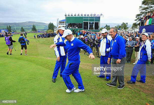 Europe team captain Paul McGinley shares a joke with Europe team vice captains Jose Maria Olazabal Sam Torrance Miguel Angel Jimenez and Des Smyth...